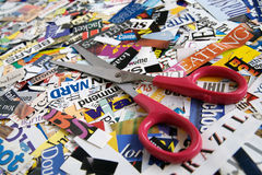 Scissors and Scrapbooking. Scissors on magazine clipping background Royalty Free Stock Photography