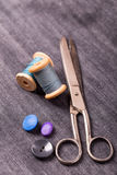 Scissors and sewing spools Stock Photos