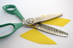 Scissors. Shears curly edges of the material handling Royalty Free Stock Photo
