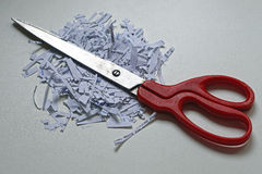 Scissors shredding paper. Scissors and shredded private documents papers Royalty Free Stock Image