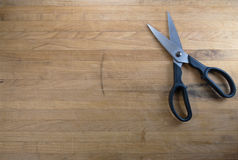 Scissors Sitting on Worn Butcher Block Stock Photos