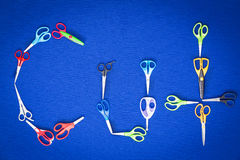 Scissors spelling the word - Cut Royalty Free Stock Photos