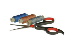 Scissors and spool of thread Stock Images