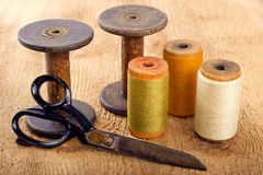 Scissors and spools Stock Image