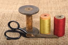 Scissors and spools Royalty Free Stock Photos