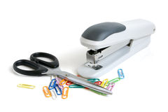 Scissors, stapler and multicolored paper clips Royalty Free Stock Images