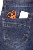 Scissors and sticker in the blue jeans pocket Stock Photography