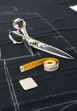 Scissors and Tape Measure on Fabric in Studio Stock Photos