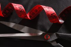 Scissors and tape measure top view Stock Images
