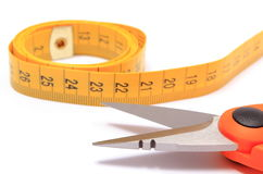 Scissors with tape measure on white background Stock Photos