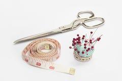 Scissors ,Tape Measuring and Needle Stock Image