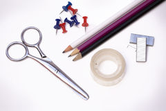 Scissors, tape, pencils and tacks. Royalty Free Stock Photography