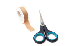 Scissors with tape Royalty Free Stock Image