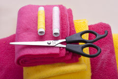 Scissors and theads on cloth Royalty Free Stock Image