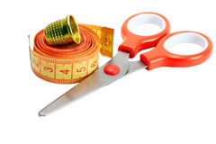 Scissors , thimble and measuring tape Stock Images