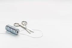 Scissors and thread Stock Image