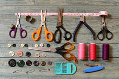 Scissors, thread, buttons and needles for sewing Stock Photography