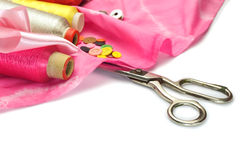 Scissors and thread with buttons Royalty Free Stock Images
