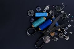 Scissors, thread and buttons. Tailoring tools and accessories on stock photos