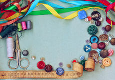 Scissors, thread, needle, thimble, variety buttons, measuring ta Royalty Free Stock Images