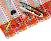 Scissors, thread and needle to coarse  canvas of mats Stock Photography