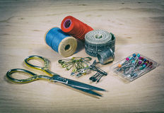 Scissors, thread, pins. Photo in old image style Royalty Free Stock Photography