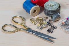 Scissors, thread, pins. Stock Photography