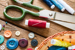 Scissors threads and buttons close up Stock Photos
