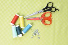 Scissors and threads on fabric, top view Tailoring equipment stock photography