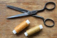 Scissors and threads Stock Photos