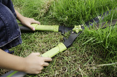 Scissors to cut the grass. Hands were cut with scissors Stock Images