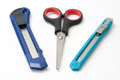 Scissors and two scalpel on a white background Royalty Free Stock Photography