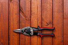Scissors on wood background Royalty Free Stock Images