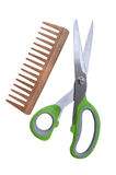 Scissors and the wooden a hairbrush Stock Images