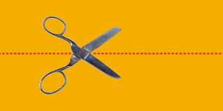 Scissors on yellow Royalty Free Stock Photos