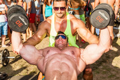 Scitec Muscle Beach. SIOFOK - AUGUST 1: Csuhai Janos (back)  Molnar Peter (front) training in Scitec Muscle Beach bodybuilding seminar on August 1, 2015 in Royalty Free Stock Photo