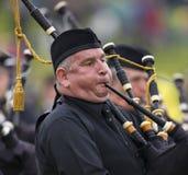 Säckpipa - höglands- lekar - Skottland Royaltyfria Bilder