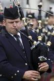 Säckpipa på de höglands- lekarna i Skottland Arkivfoto