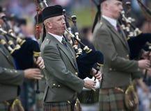 säckpipalekhögland scotland Arkivbilder