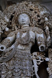 A sclupture at Halebidu temple. A fine sclupture -door keeper (dwarpala) at the west entrance of Halebidu temple. Clearly showing the trauma it has gone through Stock Photos