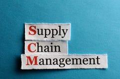 Scm abbreviation. SCM Supply Chain Management acronym on blue paper stock image