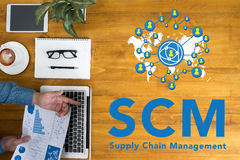 SCM Supply Chain Management concept. Businessman working at office desk and using computer and objects, coffee, top view, with copy space Stock Photography