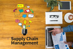 SCM Supply Chain Management concept. Businessman working at office desk and using computer and objects, coffee, top view, with copy space Stock Photo