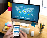 SCM Supply Chain Management concept Modern people doing business. Graphs and charts being demonstrated Stock Photos
