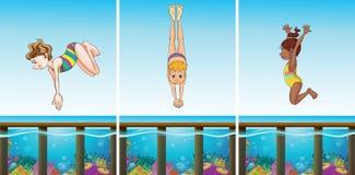 Scènes avec des personnes plongeant dans l'océan Image stock