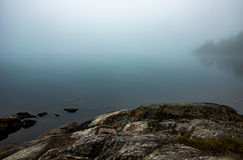 Scogliera dal lago Fotografia Stock