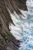 Scogliera di Gatklettur con le colonne del basalto dell'origine vulcanica, occidentali Fotografia Stock