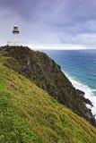 Scogliera di verde di QE Byron Bay Lighthouse Fotografie Stock Libere da Diritti