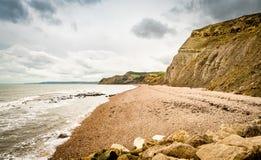 Scogliere giurassiche della costa, Cliff West Bay ad ovest Immagine Stock