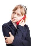 Scolara caucasica che chiama dal telefono cellulare Fotografia Stock Libera da Diritti